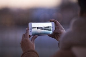Person taking pictures with phone