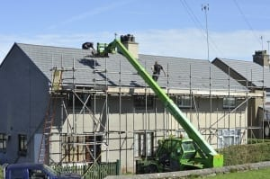 construction company repairing a roof